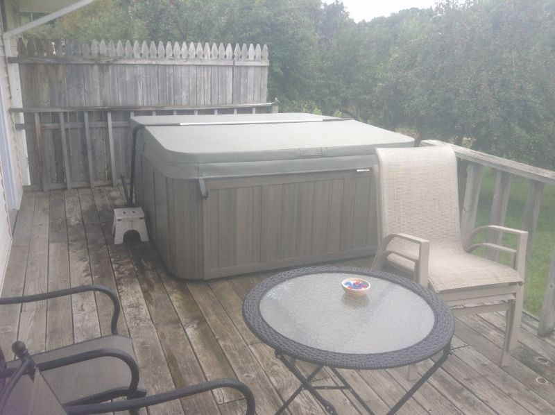 Hot tub on deck for guest use.